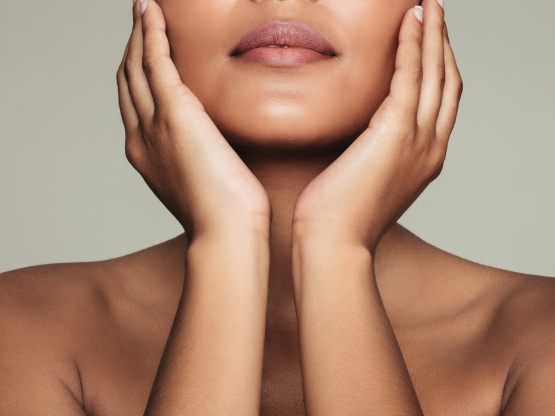 Woman touching her face.  Choose the best moisturizer for your skin type