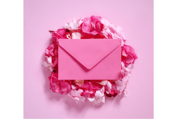 Pink Letter on Bed of Flowers