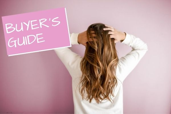 woman playing with healthy brown hair, shampoo buyer's guide