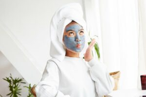 best face masks for sensitive skin, woman with skincare mask on