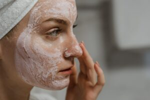 vegan skin care products, women using product on her face