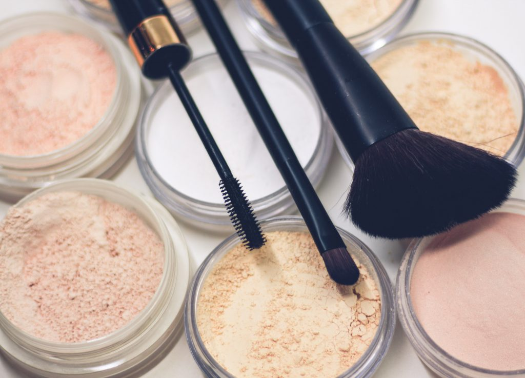 Powdered shadows in neutral colors with makeup brushes