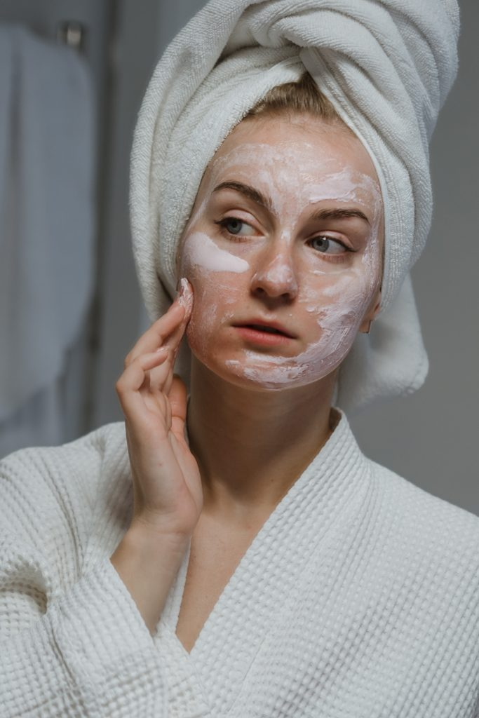 Woman Using Cream to Clean The Skin