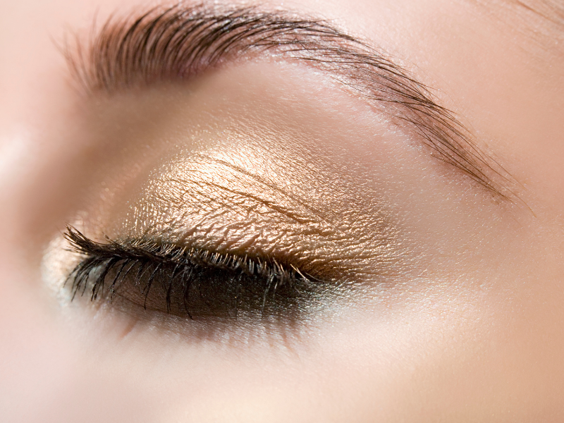 Eye with gold eye shadow.  If you have blue eyes and neutral undertones then golden eye shadow is an excellent choice.