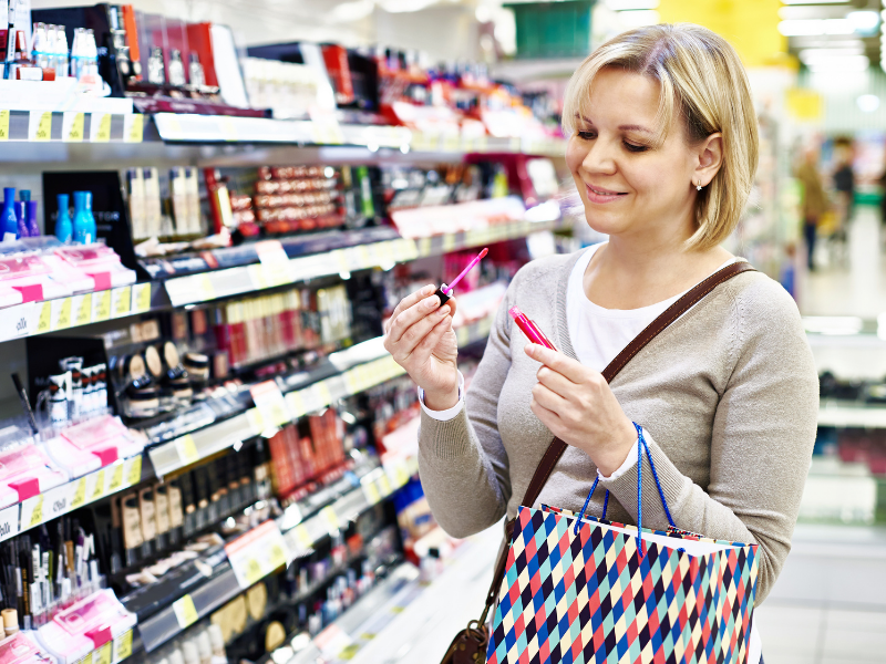 how to store liquid lipstick - You can only keep it 12-18 months.  Picture of woman Purchasing Liquid Lipstick in cosmetics aisle