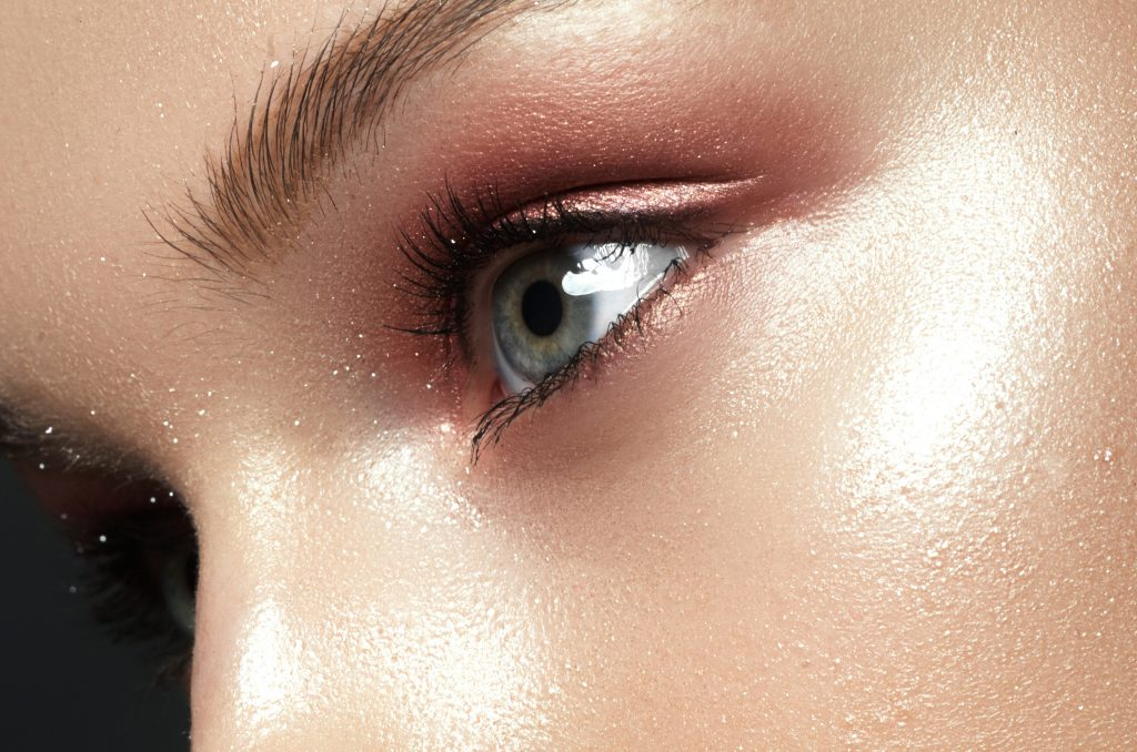 woman's cheek with a bronzed glow.  Bronze and copper are good makeup colors for hazel eyes.